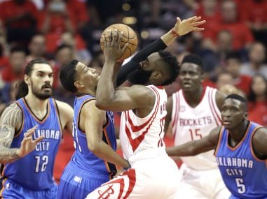 Houston Rockets' James Harden (13) drives toward the basket in the game against Oklahoma City Thunder. AP
