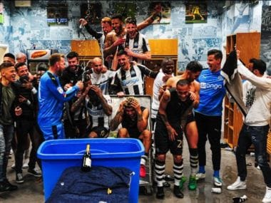 Newcastle United players celebrate after securing promotion to the Premier League. Twitter/ @NUFC