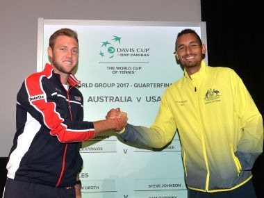 Jack Sock of the USA and Nick Kyrgios of Australia shake hands at the official draw for the Davis Cup. Getty