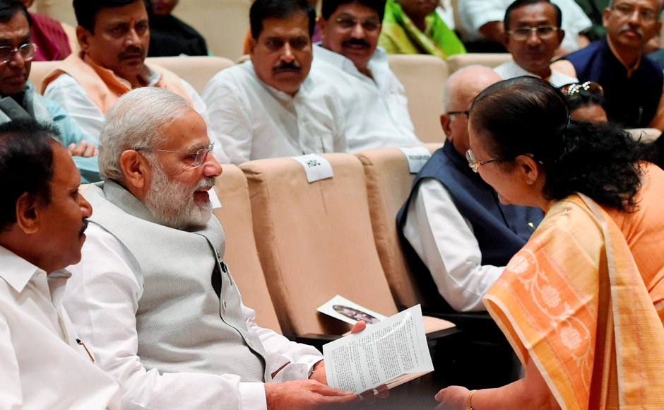 """Prime Minister Narendra Modi interacts with Lok Sabha Speaker Sumitra Mahajan at the release of the latter's book """"Matoshree"""" at Parliament Library Building in New Delhi on Tuesday. PTI"""