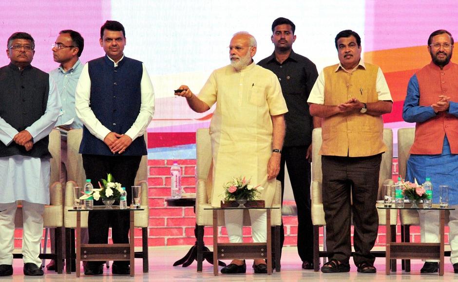 Prime Minister Narendra Modi inaugurates BHIM Aadhar schemes in Nagpur. PTI