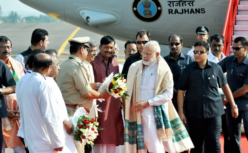 Prime Minister Narendra Modi being welcomed by party leaders upon his arrival at Biju Patnaik Airport, in Bhubaneswar on Saturday. PTI