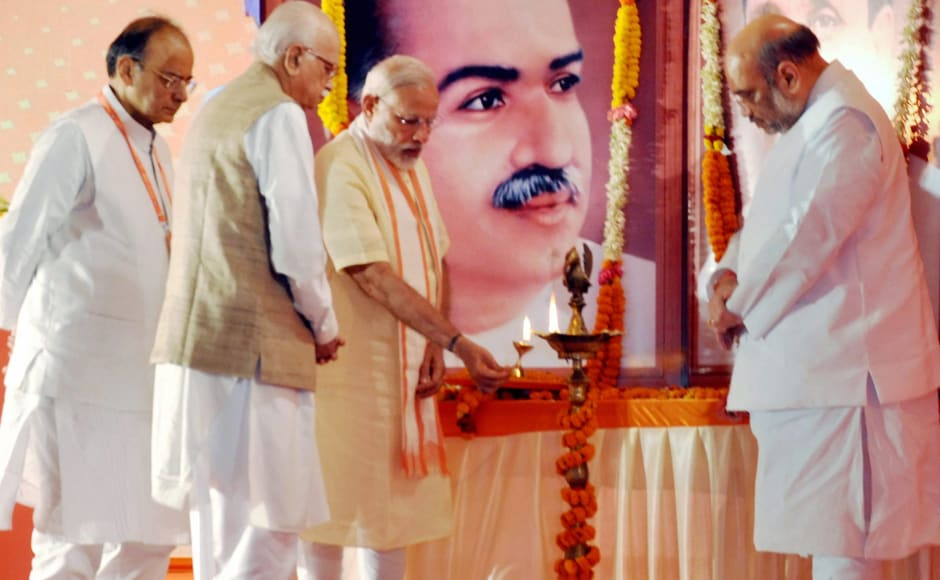 Prime Minister Narendra Modi, L K Advani, Amit Shah and Arun Jaitley light a lamp at party's National Executive Meet in Bhubaneswar on Saturday. BJP National Executive members, party office-bearers and state unit chief will discuss the future strategy of the party at the meet, which began at Sant Kavi Bheem Bhoi Sabhagar at the Janata Maidan. PTI