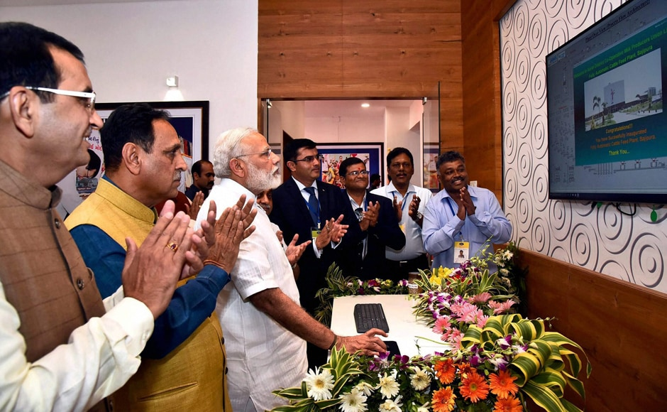 Prime Minister Narendra Modi at the inauguration of the fully automatic Cattle Feed Plant of Sumul Dairy, in Bajipura, Gujarat on Monday. Chief Minister of Gujarat, Vijay Rupani is also seen. PTI