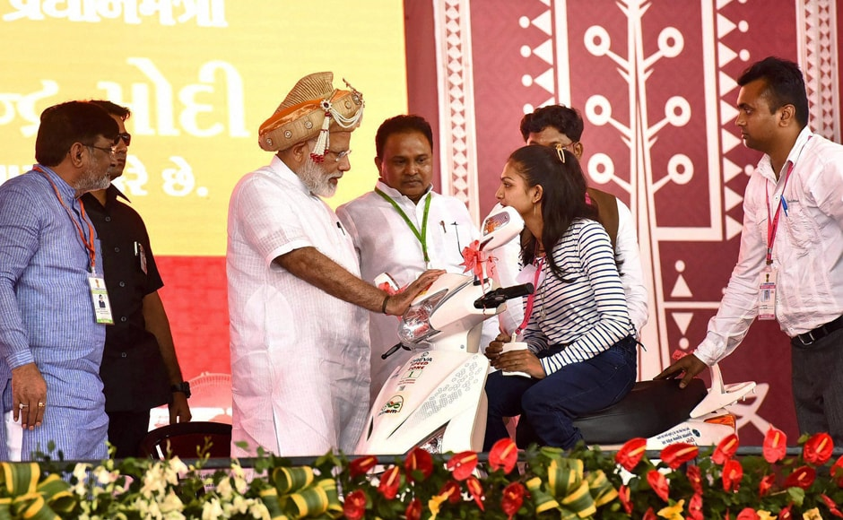 Prime Minister Narendra Modi distributing the aids and assistive devices to persons with special abilities at a function in Silvassa, Dadra and Nagar Haveli on Monday. PTI