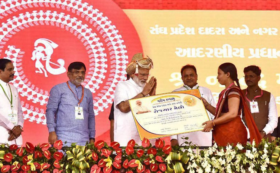 Narendra Modi distributing offer of appointment to local youths selected under Rozgar Mela, at a function in Silvassa, Dadra and Nagar Haveli on Monday. PTI