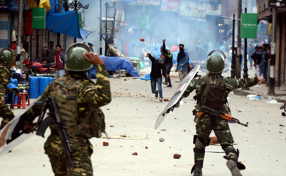 CRPF men and students throwing stones on each other during clashes after schools and colleges reopened on Monday. These educational institutions had remained closed for over a week following widespread protests by students after security forces entered a college in south Kashmir's Pulwama town on April 12. PTI