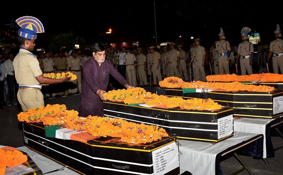Union Minister of State Ramkripal Yadav pays tributes to slain CRPF jawans at Patna airport on Tuesday. 25 CRPF jawans were killed in a Maoist attack in Chhattisgarh's Sukma district on Monday. PTI