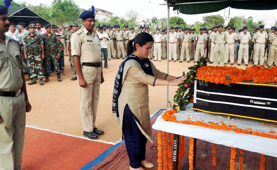 District Magistrate Neha Arora pays floral tribute to CRPF jawan Ashish Kumar Singh who was killed in Monday's Maoist attack in Chattisgarh's Sukma district, in Garhwa of Jharkhand on Tuesday. PTI