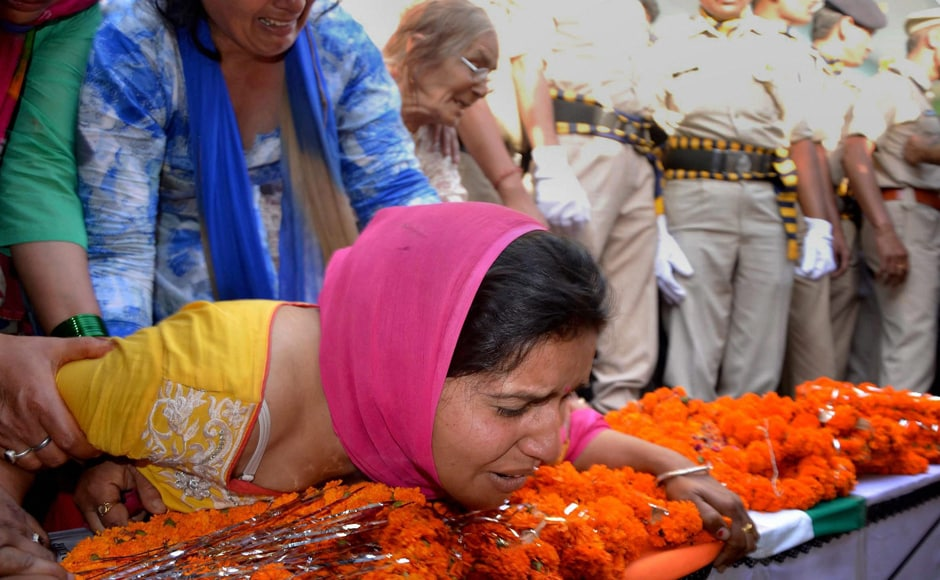 Wife of CRPF personnel Surender Thakur, who was killed in Sukma attack, mourn the loss at his native village Ner Chowk Mandi on Tuesday. PTI
