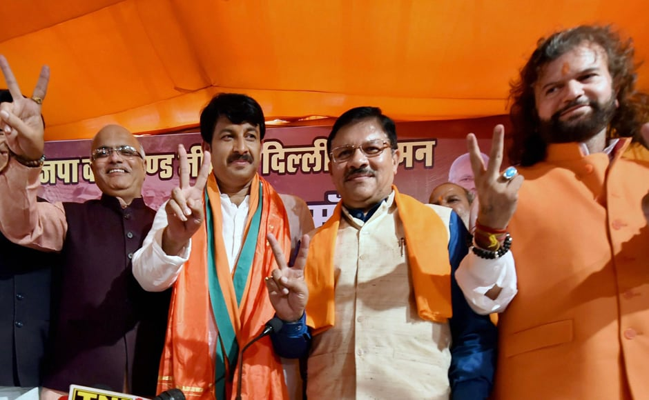 Delhi BJP President and MP, Manoj Tiwari, BJP incharge of Delhi Shyam Jaju, Hans Raj Hans and others during a press conference after BJP posted a huge victory in the MCD elections, in New Delhi on Wednesday. PTI