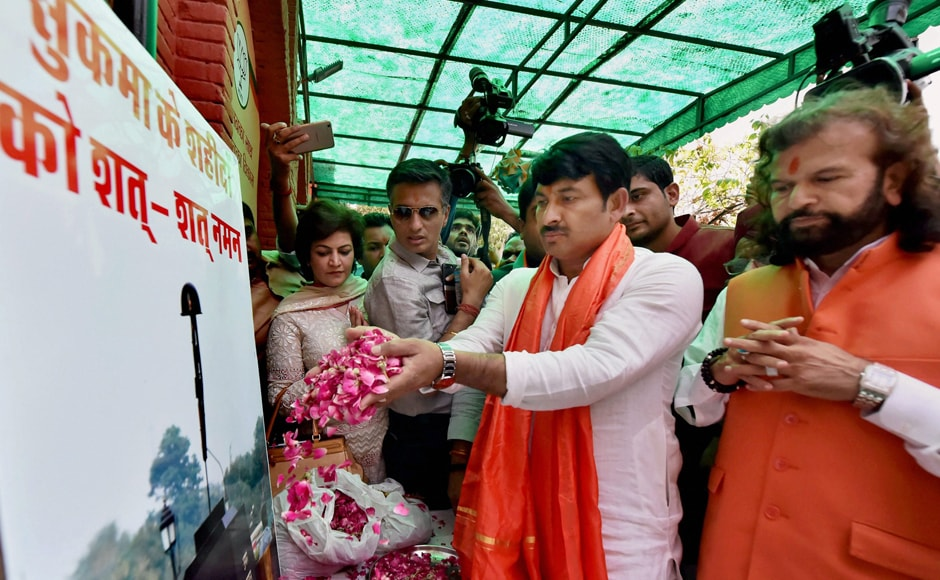 Delhi BJP President and MP, Manoj Tiwari, Hans Raj Hans and others paying homage to CRPF martyers as party dedicated its landslide win in the MCD elections to the CRPF personnel killed in the recent Sukma attack, in New Delhi on Wednesday. PTI
