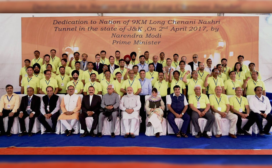 The Prime Minister, the governor and the chief minister then posed for a photograph with the engineers who were involved in construction of the tunnel. PTI