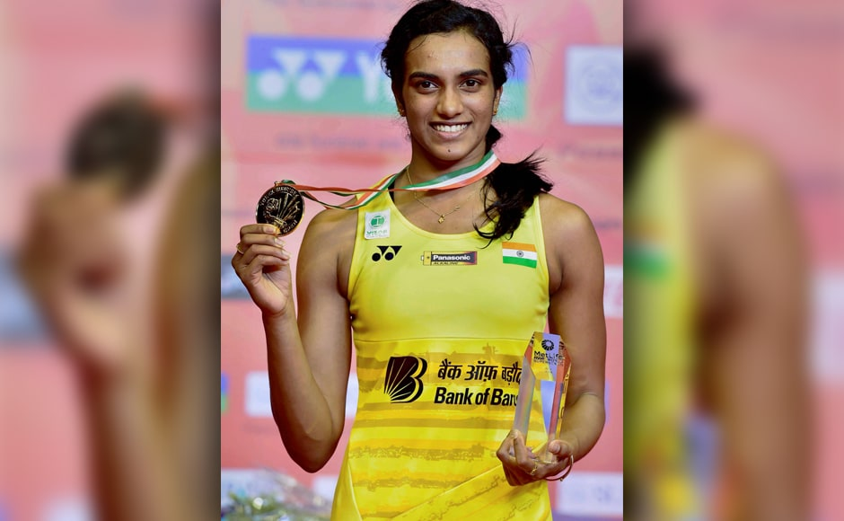 PV Sindhu is all smiles as she poses with her medal and trophy after winning the women's singles final of the India Open 2017 tournament in New Delhi on Sunday. PTI