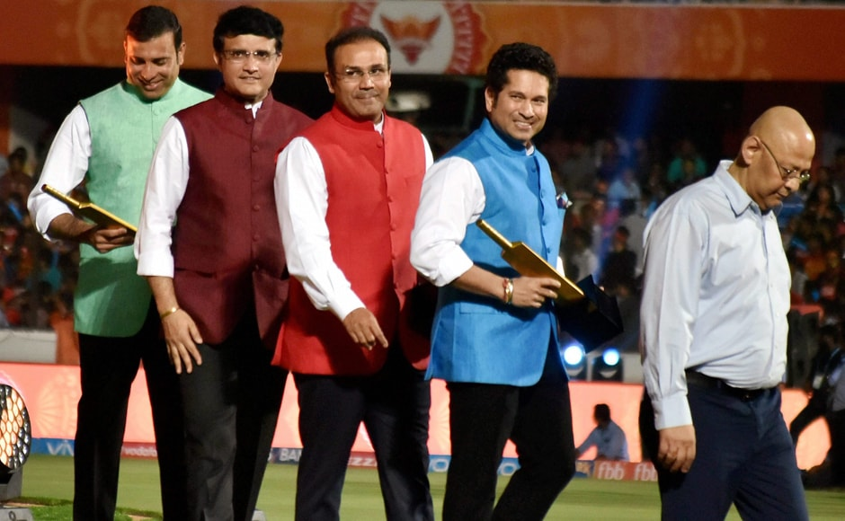 VVS Laxman, Sourav Ganguly, Virender Sehwag and Sachin Tendulkar walk back after being felicitated during the IPL 2017 opening ceremony, with BCCI vice-president Amitabh Choudhary leading the way. PTI/Sportzpics