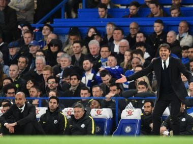 Chelsea's Antonio Conte (R) shouts instructions as Manchester City's Pep Guardiola (L) sits and watches. AFP