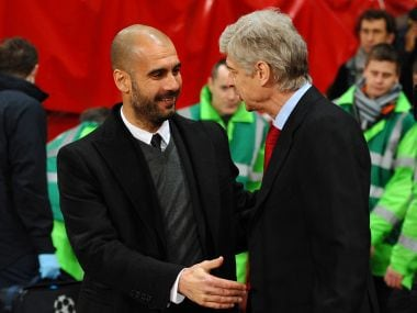 Manchester City manager Pep Guardiola (L) and Arsenal manager Arsene Wenger. AFP