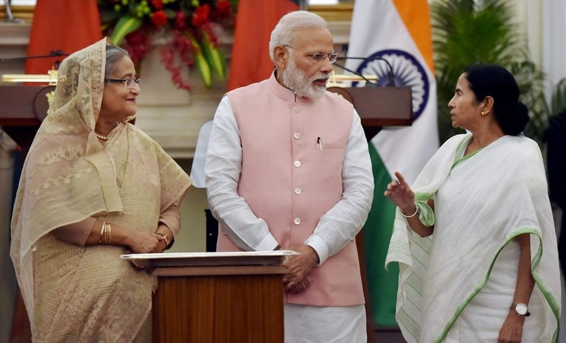 PM Narendra Modi with his Bangladeshi counterpart Sheikh Hasina and West Bengal CM Mamata Banerjee jointly flagging off Indo-Bangla train service, at Hyderabad house in New Delhi on Saturday. PTI