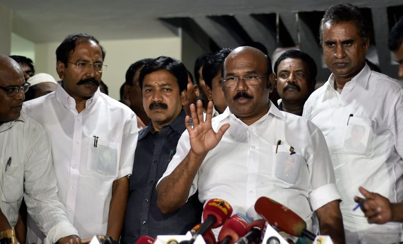 Tamil Nadu ministers addressed media after a sudden meeting to retrieve two leaves symbol in Chennai on Monday. PTI