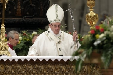 Pope Francis presides over a solemn Easter vigil ceremony in St.Peter's Basilica at the Vatican on Saturday. AP