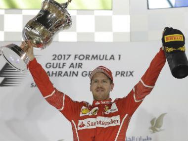 Sebastian Vettel celebrates winning his second title of the season. AP