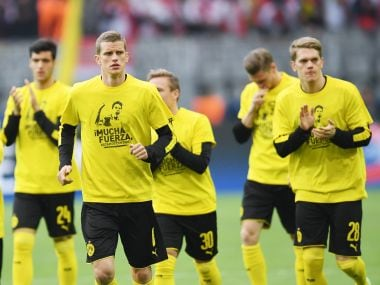 Dortmund's players wear T-shirts in honour of Marc Bartra ahead of their match against Monaco. AFP