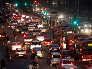 Traffic moves along a busy road in New Delhi . Reuters