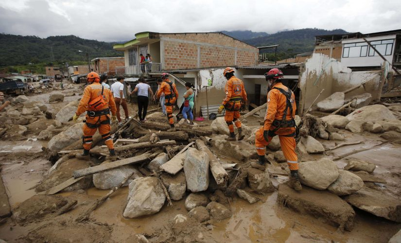 Rescuers search for survivors in Mocoa on 2 April. A grim search for the missing resumed at dawn Sunday in southern Colombia after surging rivers sent an avalanche of floodwaters, mud and debris through a city, killing at least 200 people and leaving many more injured and homeless. AP