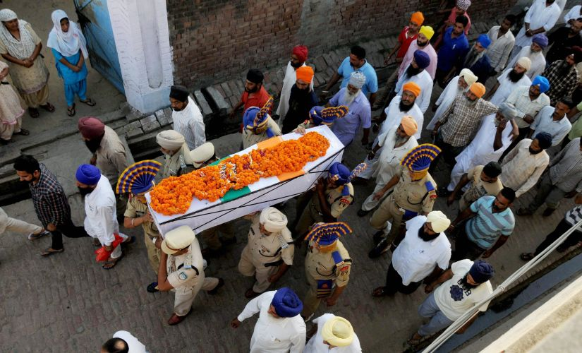 CRPF martyr Inspector Raghbir Singh being carried during his funeral in village Sathiala, 50 km from Amritsar on Tuesday. PTI