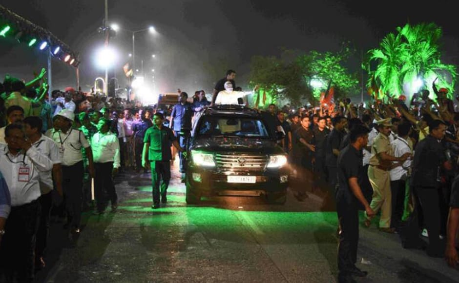 Narendra Modi with his convoy in the 11-kilometre mega roadshow in Surat, a Patidar stronghold, from Surat airport to Circuit House on Sunday. Image courtesy: @BJP4India