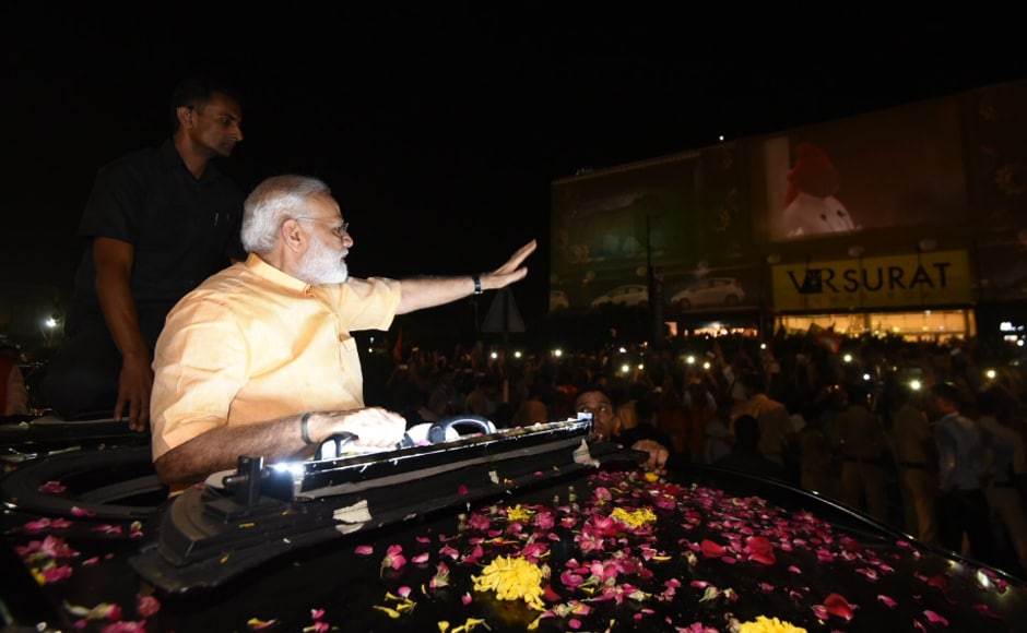 Prime Minister Narendra Modi met with a grand reception during the 11-kilometre mega roadshow in Surat, a Patidar stronghold, on Sunday. Image courtesy: @BJP4India