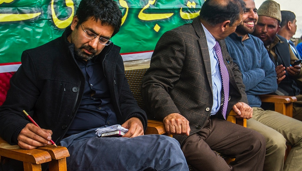 PDP's new face and cinematographer Tasaduq Mufti  during a party worker-cum-public meeting in Shopian, South Kashmir, on Monday, 3 April 2017. Photo by Javeed Shah