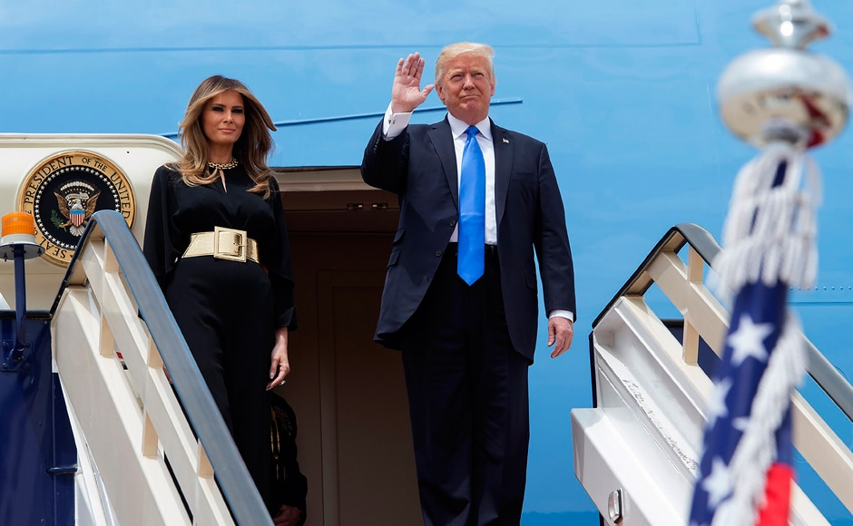 The White House announced a huge arms deal with Saudi Arabia on Saturday as President Donald Trump took his first steps on the world stage, looking to leave mounting troubles behind at home. Trump (R) and First Lady Melania Trump arrived at King Khalid International Airport in Riyadh on Saturday. AFP