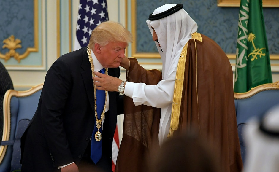 The US president was given a warm welcome in the oil-rich kingdom — a mood in sharp contrast to Washington where pressure is building after fresh claims over his team's alleged links to Moscow. Trump received the Order of Abdulaziz al-Saud medal from Saudi Arabia's King Salman bin Abdulaziz al-Saud (R) at the Saudi Royal Court in Riyadh on 20 May, 2017. AFP