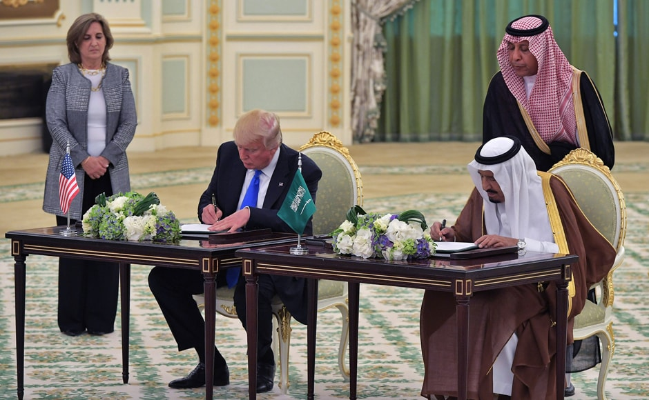 US President Donald Trump (L) and Saudi Arabia's King Salman bin Abdulaziz al-Saud take part in a signing ceremony at the Saudi Royal Court in Riyadh. AFP