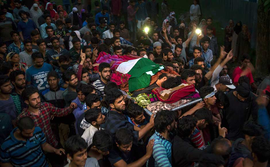 Hizbul Mujahideen commander Burhan Wani's successor, 21-year-old Sabzar Bhat alias Abu Zarar, was gunned down in an encounter in his hometown of Tral, Kashmir on Saturday. Kashmiri villagers carry the body of rebel leader Sabzar Ahmed Bhat towards his home after displaying his body in Tral area. AP