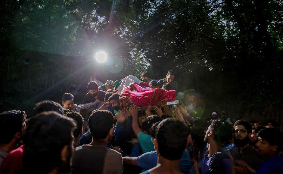 Authorities clamped a curfew across most of Kashmir for the first day of the Muslim Ramadan festival Sunday and partially cut telephone services to thwart protests over the killing of the top rebel commander. AP