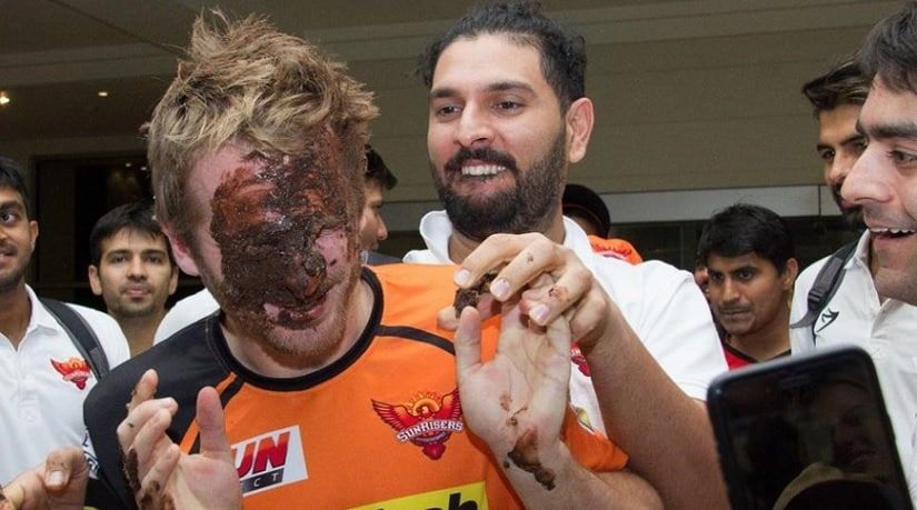 That's Yuvraj Singh giving Kane Williamson a face full of cake after the latter had helped them win against Delhi Daredevils.