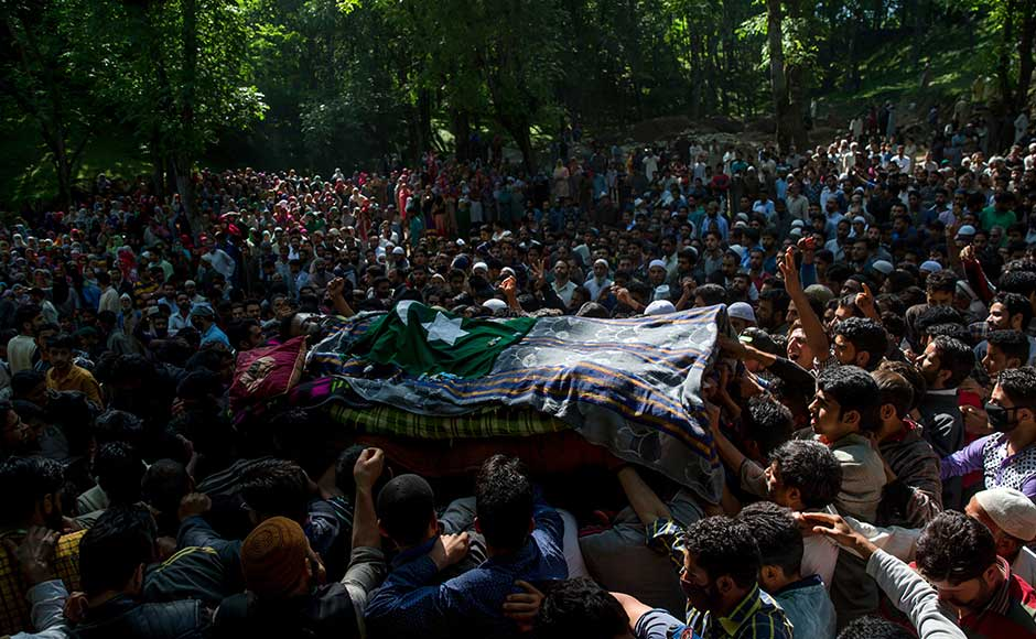 A protester was shot dead by troops during clashes as hundreds of villagers tried to break the security cordon to help the militants to escape. Clashes spread to other districts, leaving dozens injured. Some persons reported at hospitals with pellet gunshots, according to attending doctors. AP