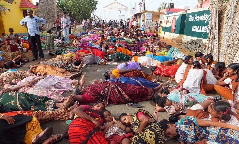 Demonstrators lie on a road during a protest near the Kudankulam nuclear power project. Reuters