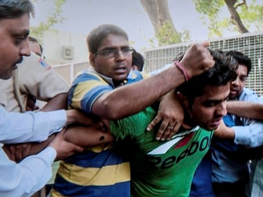 AAP supporters thrash Ankit Bhardwaj, who attacked Kapil Mishra on Wednesday. PTI