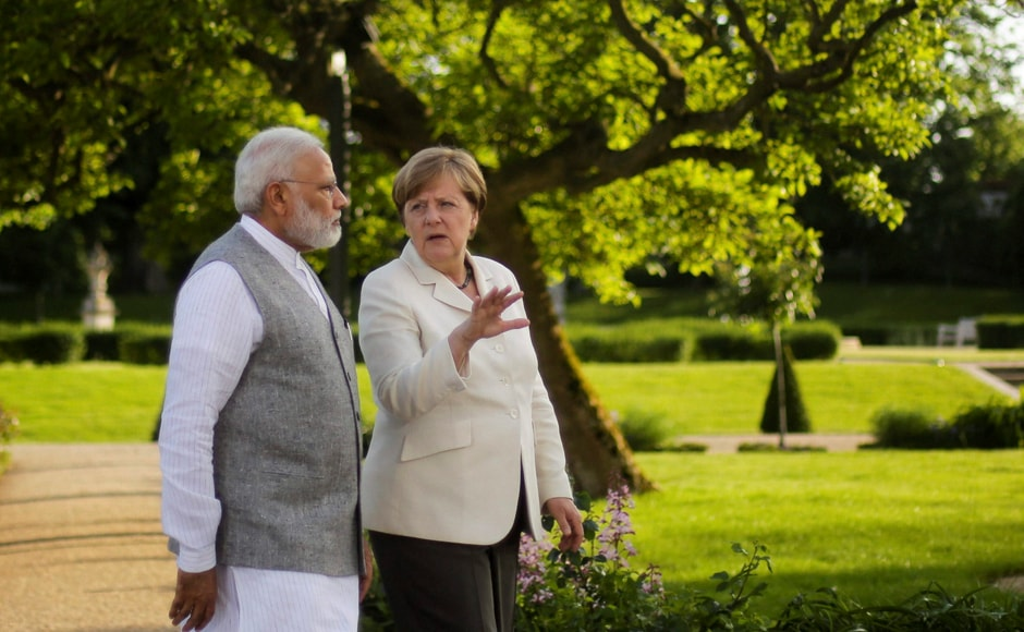 Berlin : German Chancellor Angela Merkel, centre and Indian Prime Minister Narendra Modi, walk through the garden of the government guest house Meseberg Palace, during a meeting in Meseberg, about 70 kilometers (43 miles) north on Berlin, Monday, May 29, 2017. AP/PTI(AP5_29_2017_000224B)