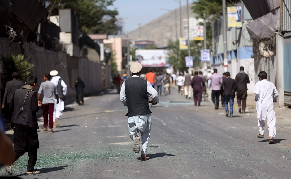 "People run to the hospital near the site of a suicide attack in Kabul, Afghanistan. The ministry called on Kabul residents to donate blood, saying hospitals were in ""dire need"". AP"
