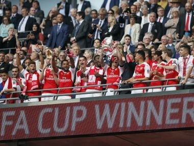 Arsenal players celebrate with the trophy after winning the FA Cup. AP Photo