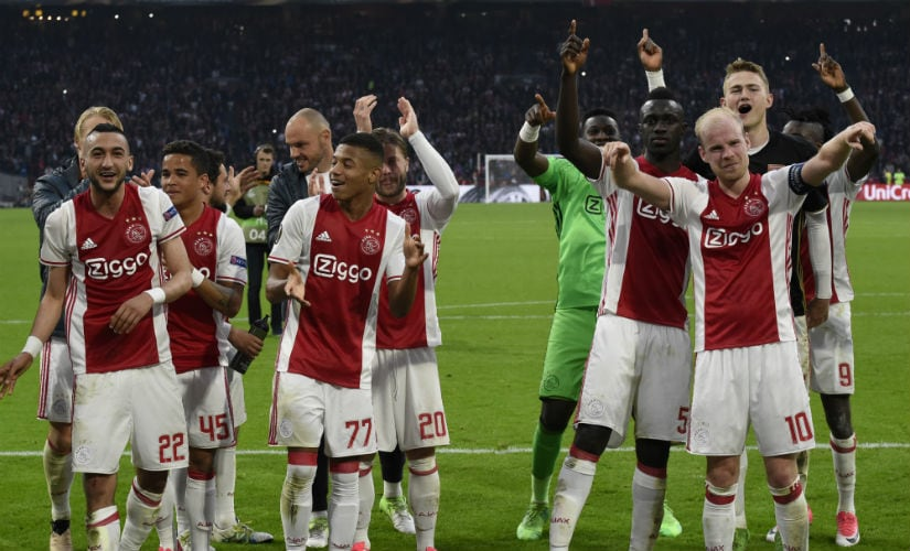 Ajax players celebrate after winning 4-1 against French side Lyon in Amsterdam. AFP