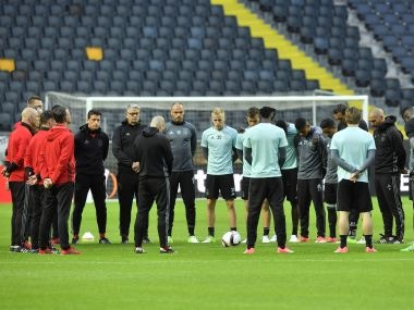 Ajax players gather on the pitch before a training session at the Friends Arena in Stockholm, Sweden, Tuesday, May 23, 2017. Ajax Amsterdam and Manchester United will play the soccer Europa League final in Stockholm on Wednesday, May 24. (AP Photo/Martin Meissner)