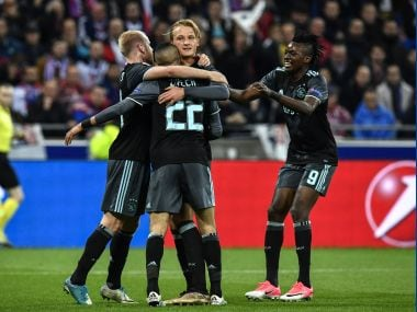 Ajax' Kasper Dolberg (C) celebrates with his teammates after scoring during the Europa League semi-final. AFP