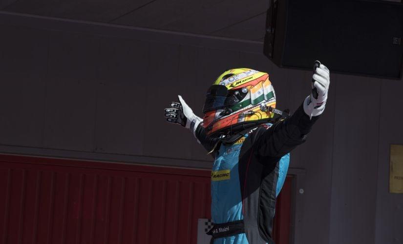 Arjun Maini celebrates his win after the race.