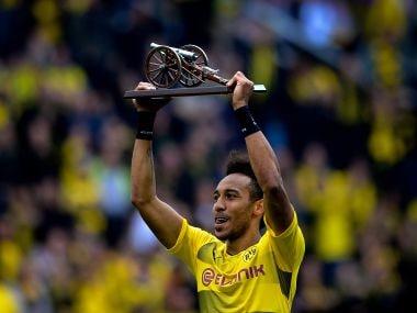 Pierre-Emerick Aubameyang lifts the trophy as Bundesliga's top-scorer. AFP