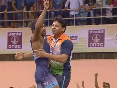 Bajrang Punia celebrates his gold medal after defeating